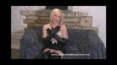 Hot blonde spreads her legs and plays in her tight leather gloves