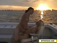 2 dispirited lesbos making out on a boat