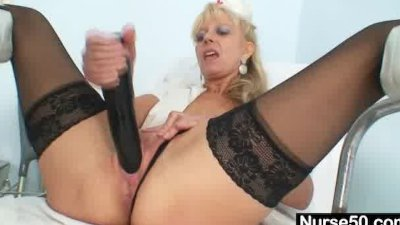 Old blonde milf stuffing pussy with huge dildo