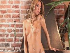 Beautiful blonde babe does a sexy striptease