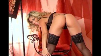 Blonde masturbates in panties and sheer stockings