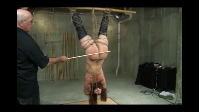 Collared slave gets caned