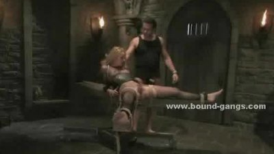 Blonde with hands and legs tied in ropes