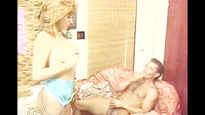 Lady pets dick with mouth and