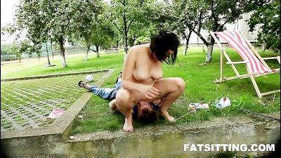 Busty brunette plumper smothering face outdoors