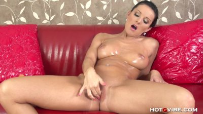 Oiled Up Nympho Squirts All Over The Couch