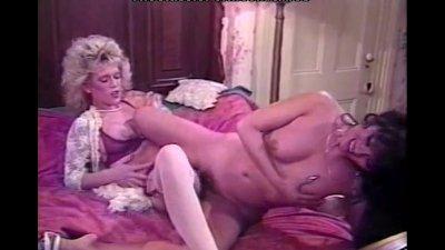 Kinky lesbian couple bedroom fun