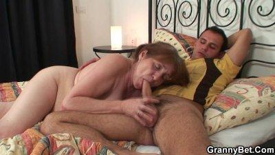 Grandma rides his hard meat