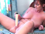 classy granny plays with her dildo collectionPorn Videos