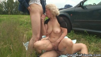 Old slut swallows two cocks in fields