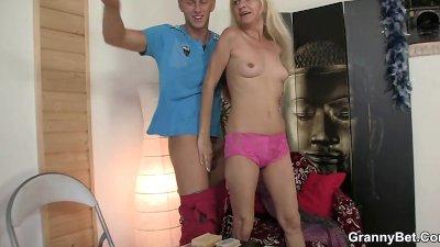 Blonde oldie sucks and rides his meaty dick