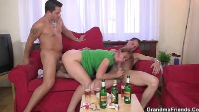 Hot woman takes two cocks at once