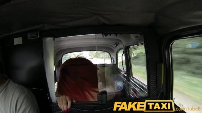 FakeTaxi Red head takes on older cock