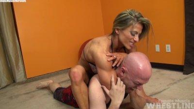 Muscular Blonde Wrestles wimp!