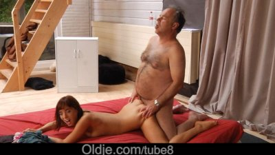 Young elastic girl doing acrobatic sex with an old man