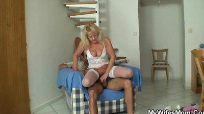 Old blonde jumps on massive meat