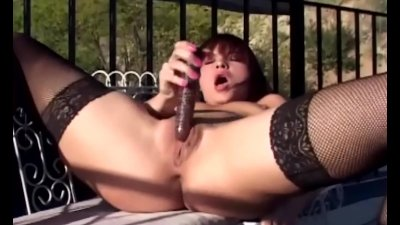 Masturbation outdoors in black fishnet stockings