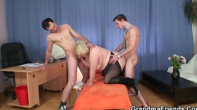 Two dudes have fun with busty blonde grandma