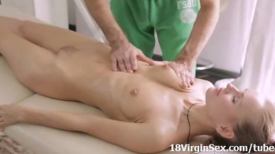 Teen Julie lets masseuse fuck her fresh trimmed pussy