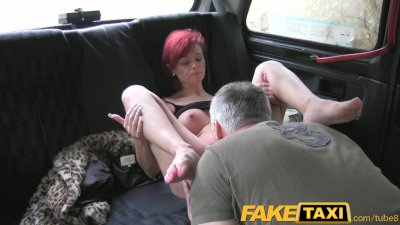 FakeTaxi Short haired redhead fucked from behind by taxi driver
