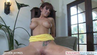 Busty brunette Jayden Jaymes slurps a large prick
