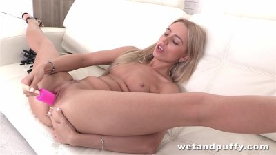 Blonde Alina Bell enjoys a butt plug while using a toy on her pussy