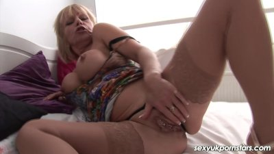 Mature British pornstar plays with her pussy in stockings