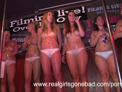 hot college girls stripping on stage for a wet t shirt contest