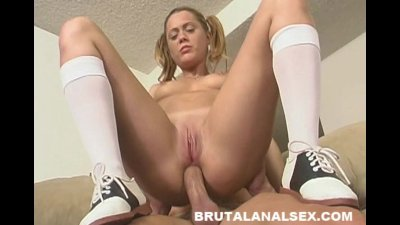 Dynamite has her throat and asshole gaped by a thick cock
