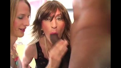 Cock hungry crossdresser sluts take turns sucking big black spunking cock