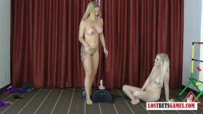 """Two blondes play a strip game of """"throw the balls"""""""