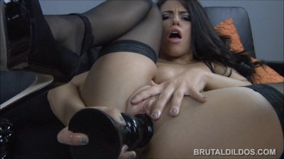 Brunette pornstar fucking both her holes with huge brutal dildos in HD