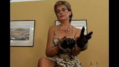 Lady Sonia in fur gloves playing with a slave.