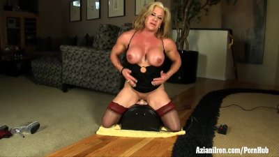 Big beautiful bodybuilder rides the Sybian while wearing thigh highs
