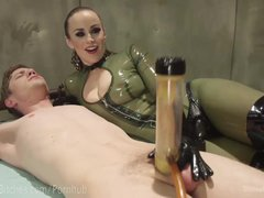 Latex Dominatrix Milks Slave Boy