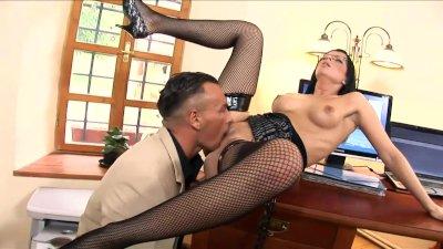 Sexy secretary fucked on a desk in ebony fishnet stockings and high heels