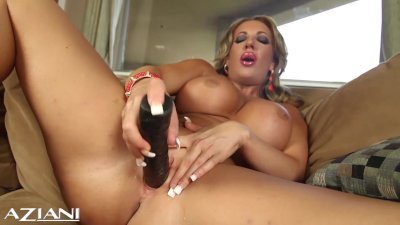 Hot and horny babe strips and fucks her pussy with big black dildo
