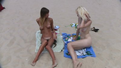 teen nudists get naked and heat up a public beach