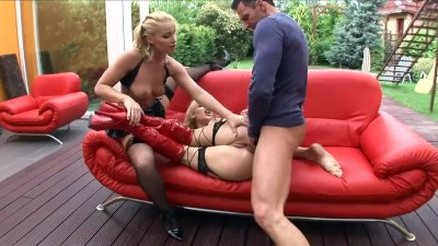 Blondes Brittany and Caty getting fucked on a couch in stockings and boots