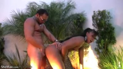 Hot ebony shemale with hazel eyes gets anal fucked outdoors
