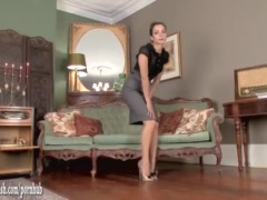 Hot brunette masturbates in stunning leopard print heels and vintage nylons