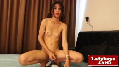 Masturbating ladyboy spreads her gaped ass